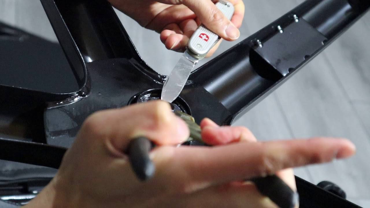 check the screws  - How to fix a squeaky office chair